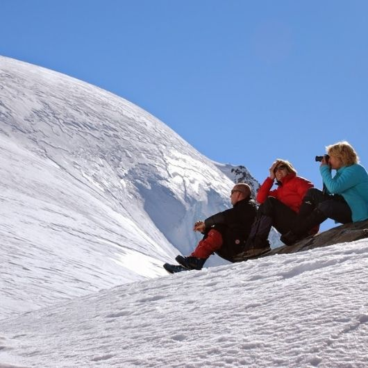 Friends sitting on top of the world on Aoraki Mt Cook