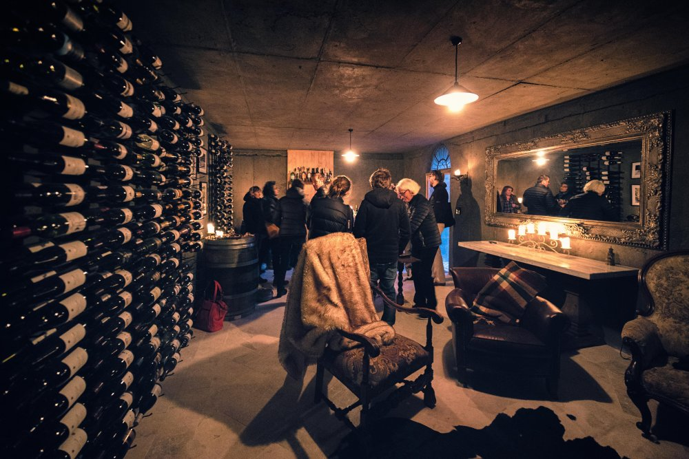a gathering inside pukaki wine cellar and observatory