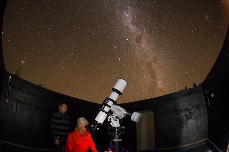 gazing through telescope pukaki wine cellar observatory