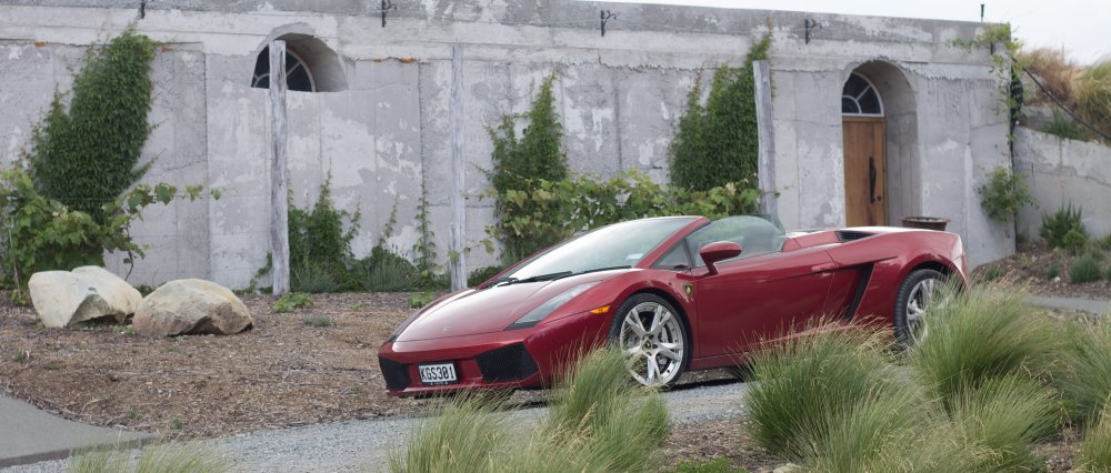 luxury car parked at mt cook lakeside retreat