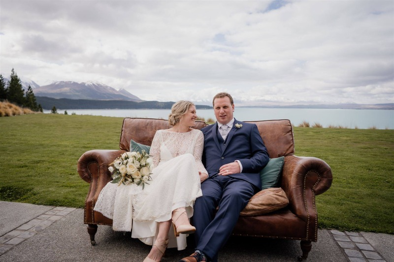 wedding couple posing for photographs at mt cook lakeside retreat